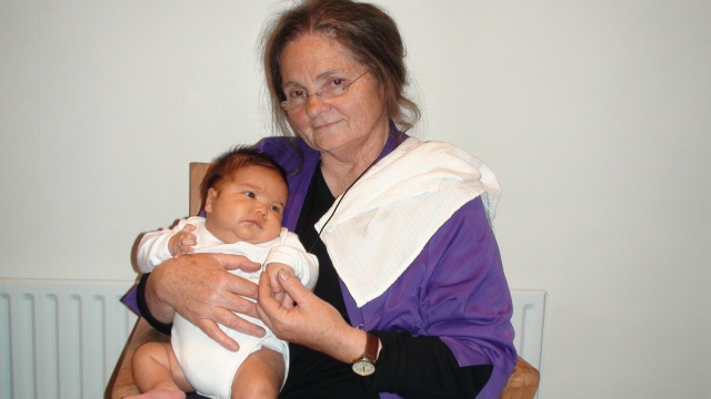 Iris holding her newborn nephew, Alex, in April 2009
