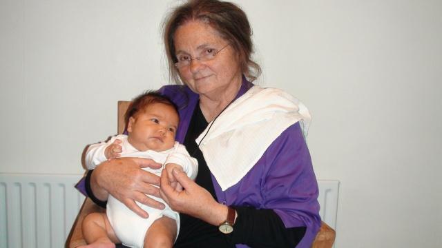 Iris holding her newborn nephew, Alex, in April 2009