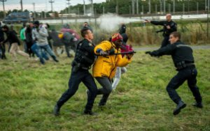 French gendarmes attack migrants
