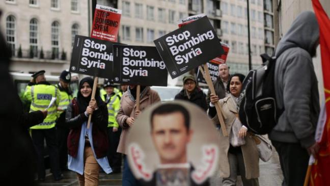 Syria demo, Assad portrait